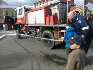 Highlight of the weekend - ran into some firemen and they even let the boys use the fire hose :)