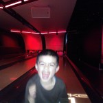 Matthew beats Ben at bowling.